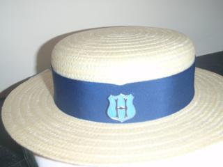 Helvetia Metal Hat Badge